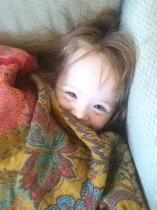 little girl peeking